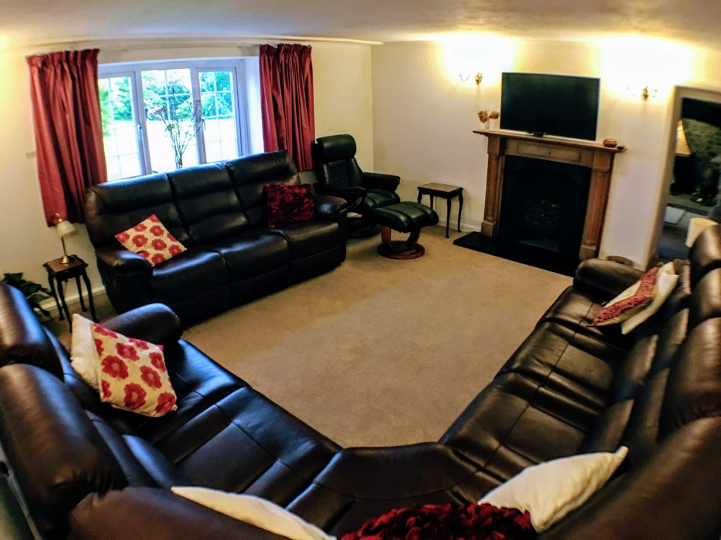 Upper living room with smart TV & recliners